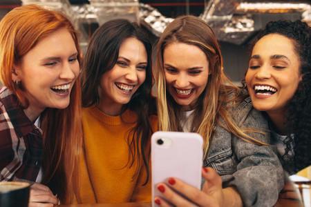 Cheerful friends taking selfie