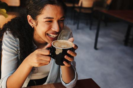 Woman enjoying having coffee at a cafe