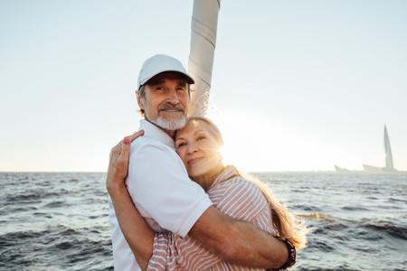 Senior man and woman embracing