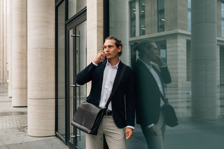 Busy man standing at office