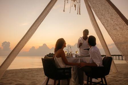 Couple on a dinner date at beach restaurant