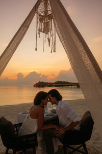 Couple on honeymoon at an exotic beach resort
