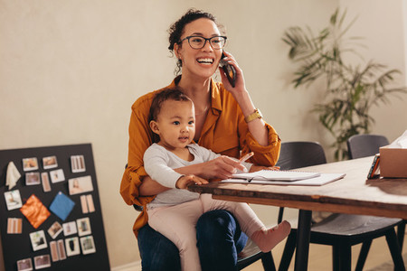 Working mom handling her business from home