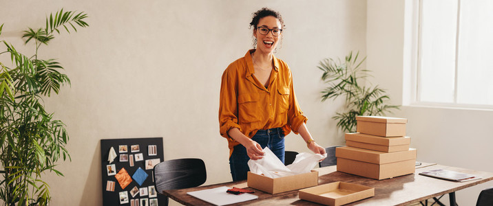 Drop shipping business owner working at home office