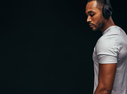 Portrait of african american man listening to music