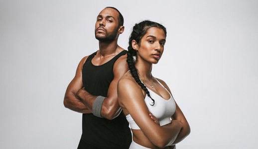 Fit couple standing on white background