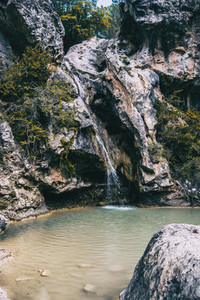Small crystal clear waterfall inside the forest on a mountain in Prades  Spain
