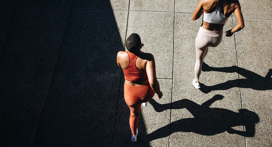 Female friends running together