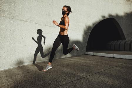 Female athlete on morning running workout