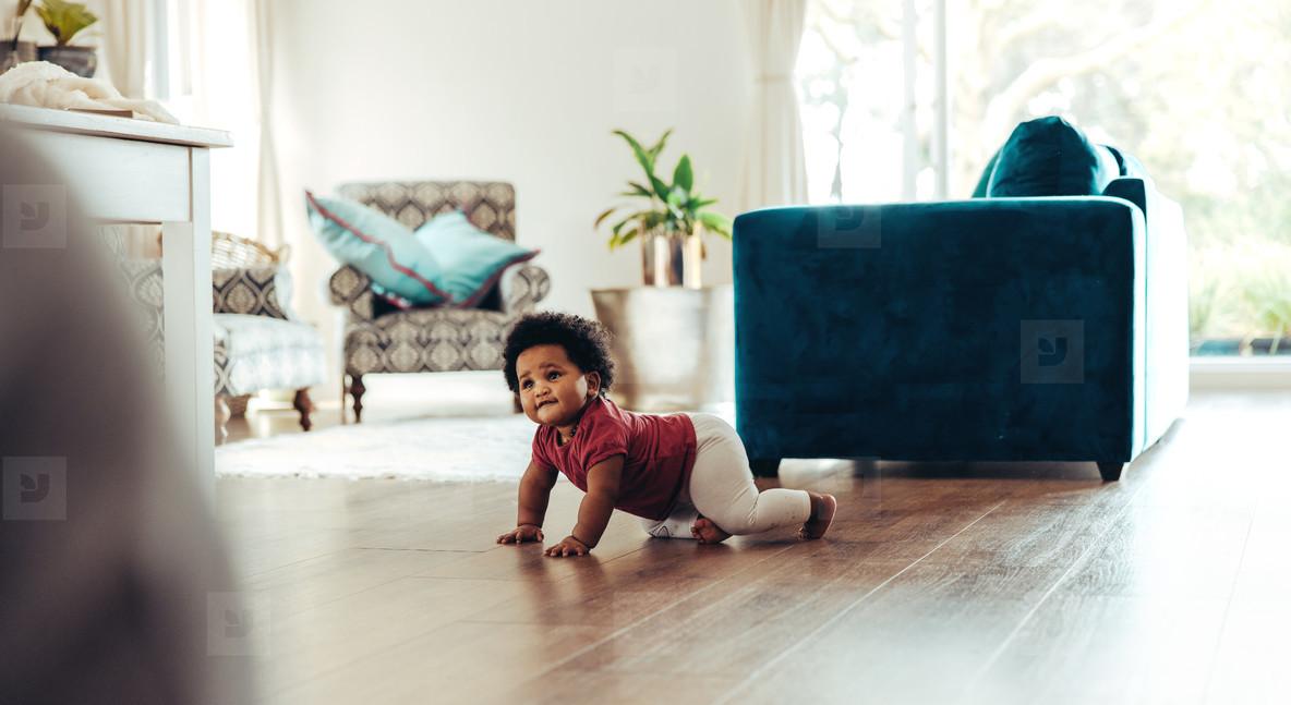 Cute baby crawling on floor