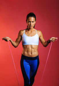 Portrait of fitness woman training with stretch bands