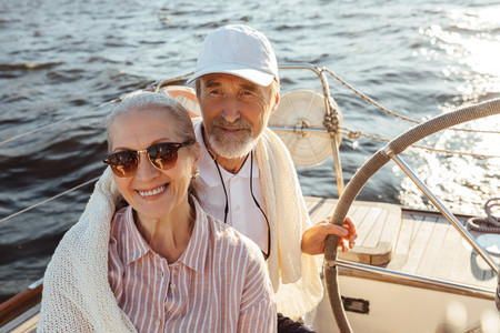 Elderly people enjoying a vacation on their sailboat