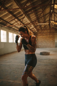 Fit young woman practicing shadowboxing