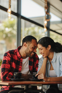 Loving couple at a coffee shop together