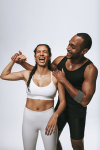 Fit couple having fun after workout
