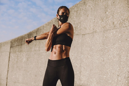 Sportswoman doing warmup workout outdoors