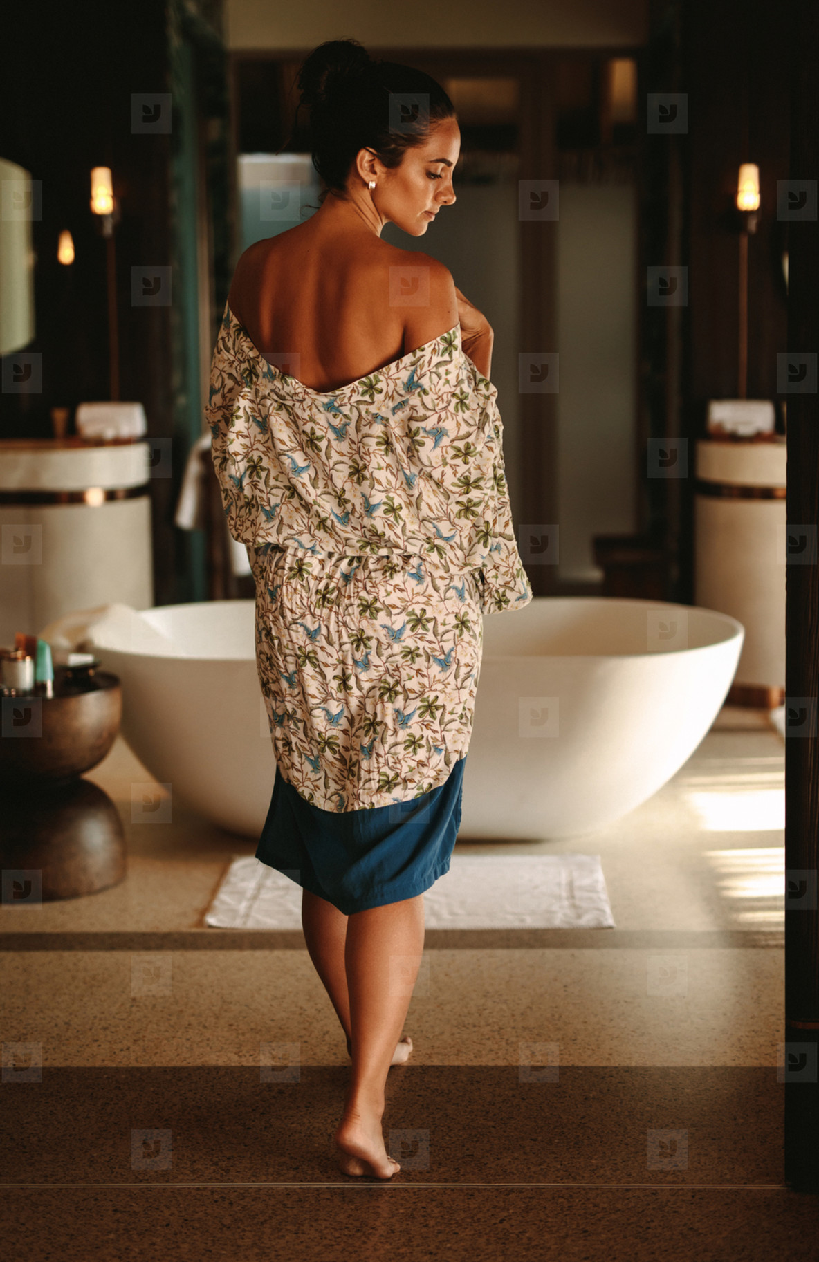 Woman getting ready for a luxurious bathing experience