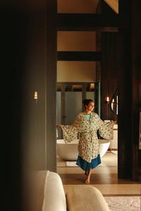 Woman walking inside a luxury hotel