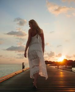 Tourist woman walking on a jetty