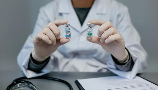 Doctor showing two coronavirus vaccine options
