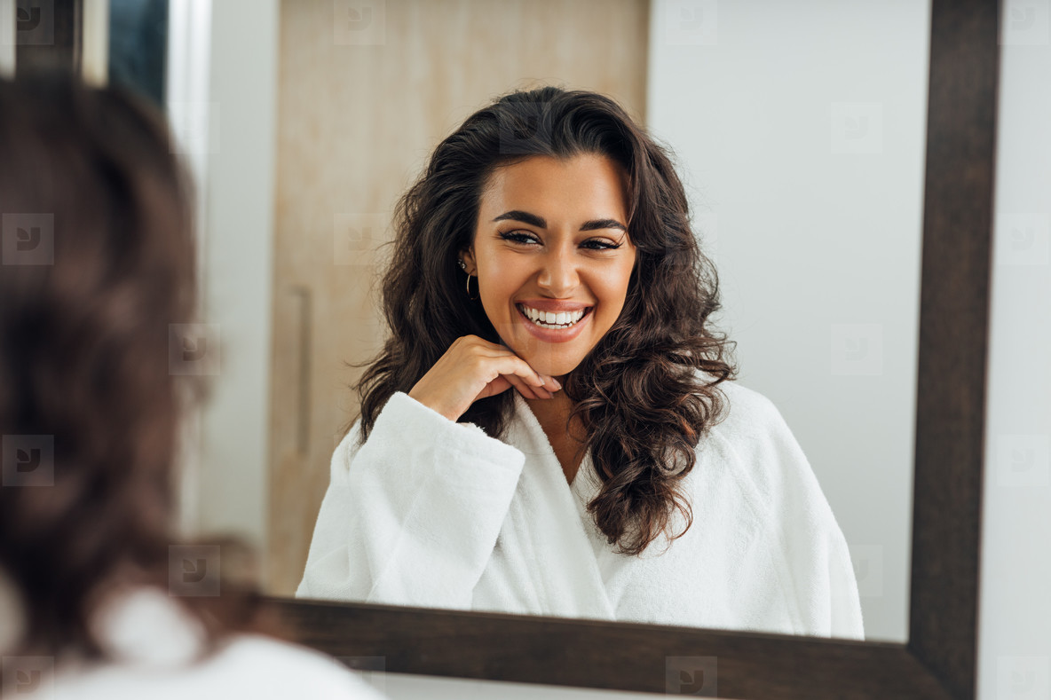 Reflection of happy woman in the mirror