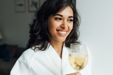 Beautiful cheerful woman with bocal of wine
