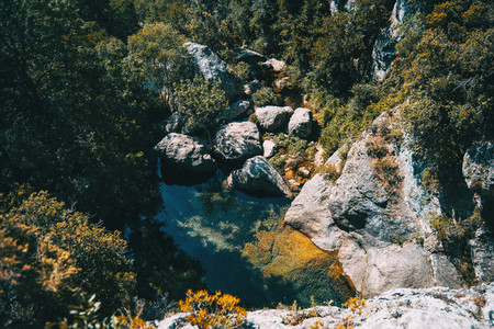 landscape of a small waterfall in a forest of tarragona  spain