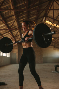 Fitness woman exercising with a heavy weights