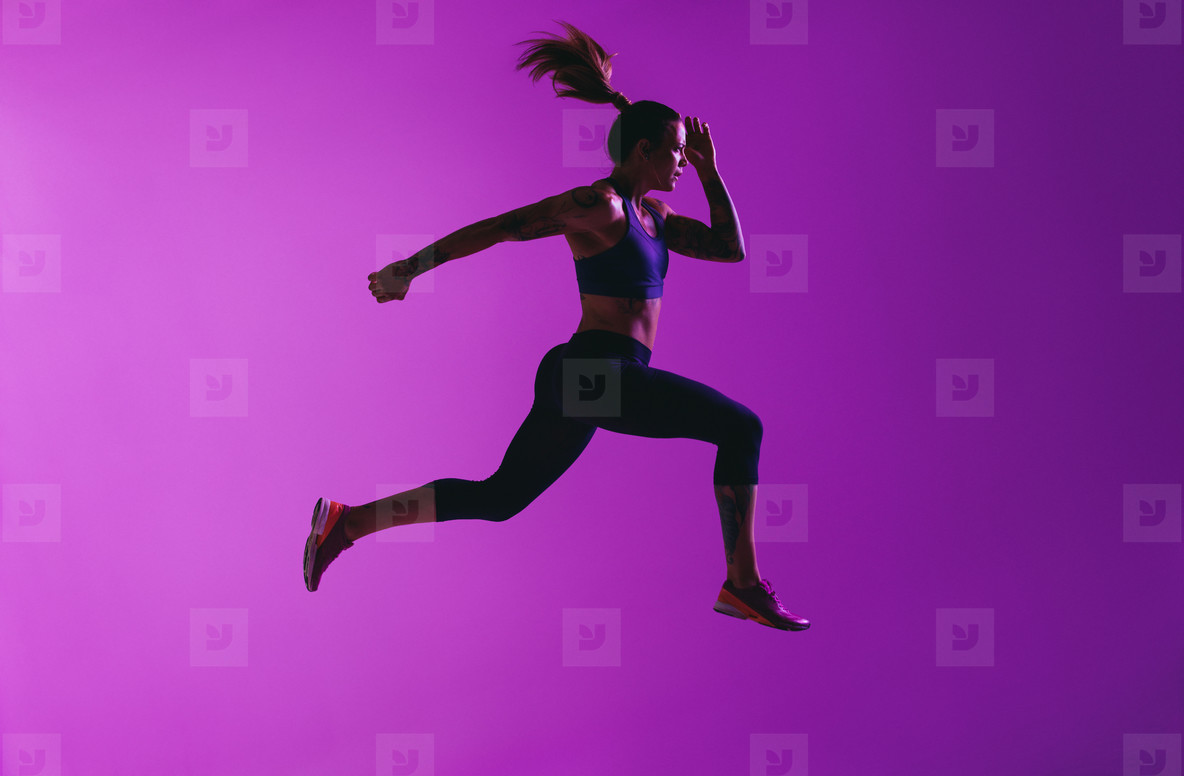 Side view of fit woman running