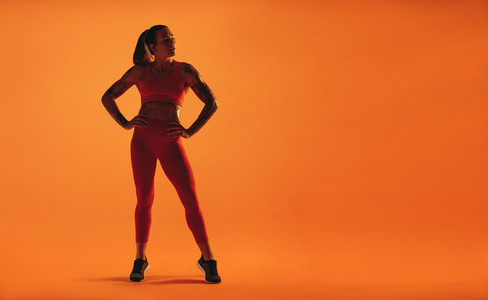 Monochrome portrait of a fit woman exercising