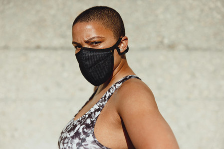 Healthy woman wearing a face mask