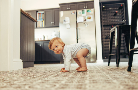 Baby trying to stand on his feet