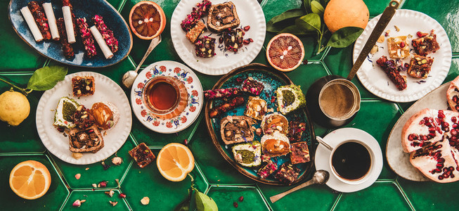 Turkish traditional lokum with tea and coffee over green tile