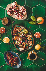 Turkish traditional lokum with coffee over green tile table