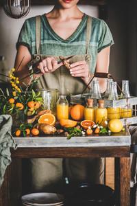 Young woman making fruit immune boosting drink to resist virus