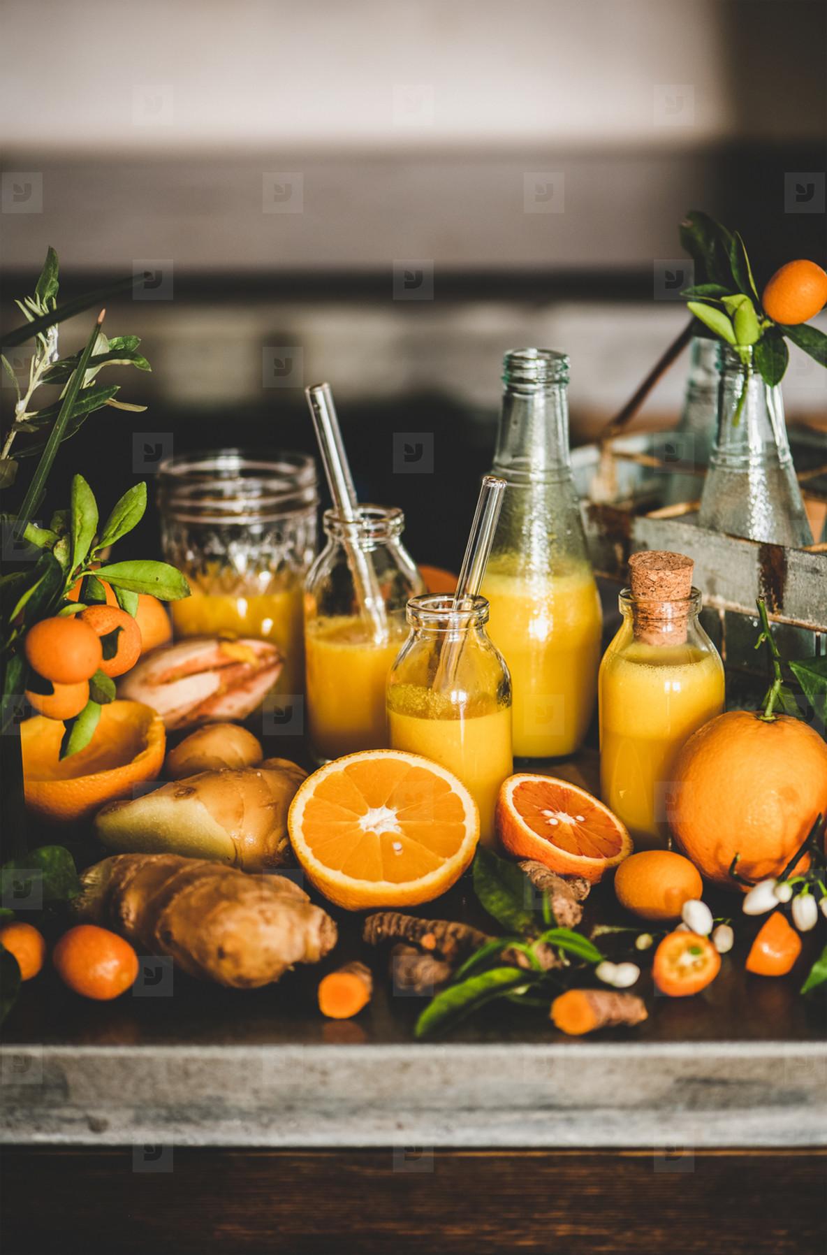 Fresh fruit vitamin immune boosting drink over concrete kitchen counter