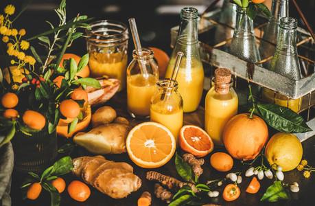Fresh fruit vitamin immune boosting drink in bottles and ingredients