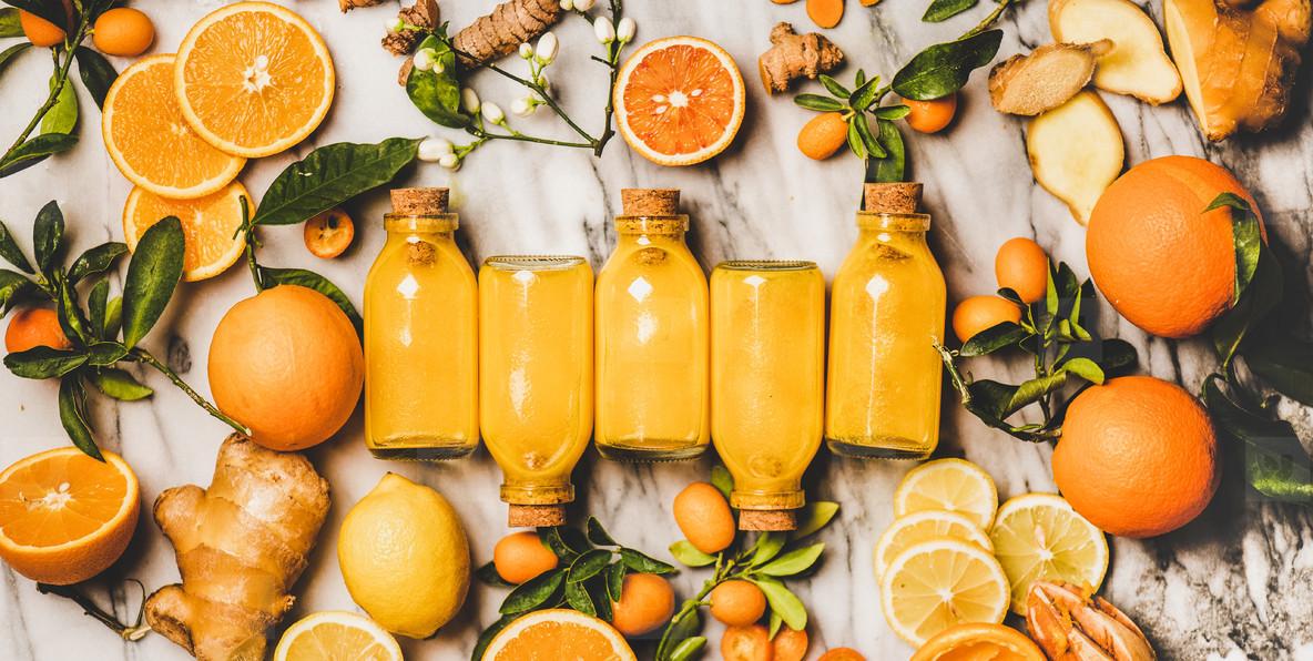 Immune boosting turmeric  ginger  citrus juice shot in bottles