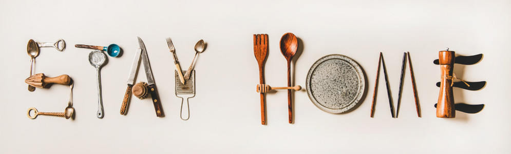 Stay at home lettering made from kitchen utensils  top view