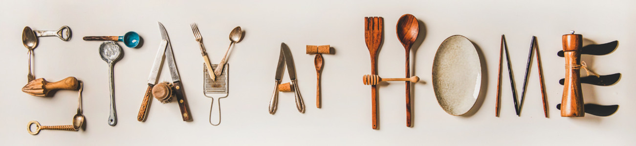 Stay at home lettering made from kitchen utensils  wide composition