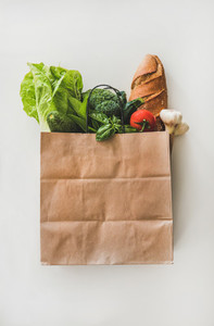Online grocery healthy food shopping in paper bag  top view