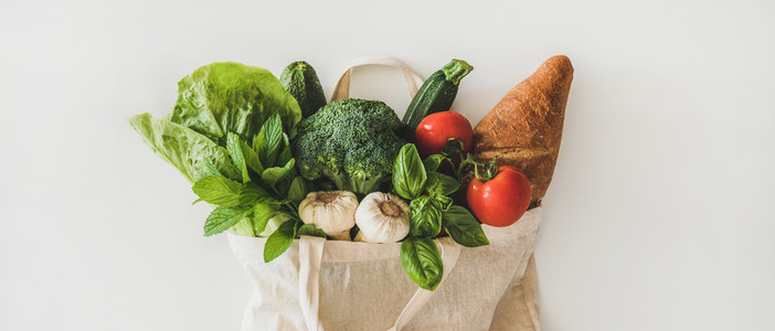 Online grocery healthy food shopping in eco friendly bag  wide composition