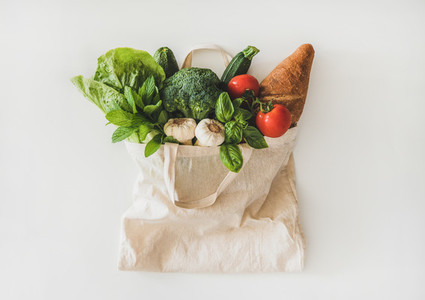 Online grocery healthy food shopping in eco friendly bag  top view