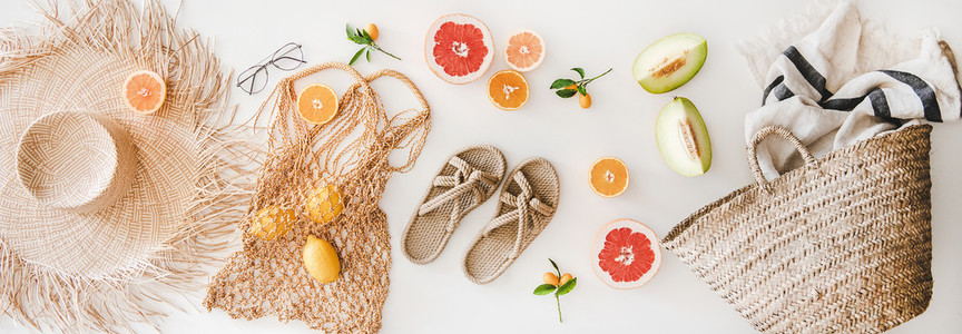 Summer mood layout with feminine accessories and fruits  top view