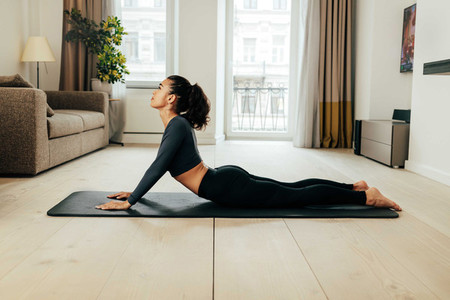 Side view of woman doing stretching exercises