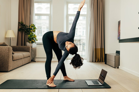 Woman repeating exercises at home