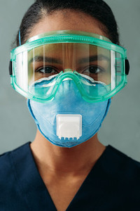 Close up portrait of a medical specialist in respirator