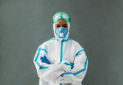 Portrait of a confident medical specialist wearing a protective suit