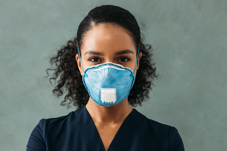 Portrait of a young nurse wearing respirator