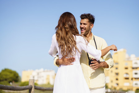 Happy loving couple hugging each other outdoors